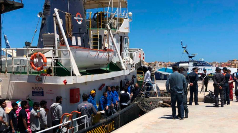 Rescued migrants disembark from the Mare Jonio rescue ship as it docked at the port of the Italian island of Lampedusa on May 10. - Courtesy photo