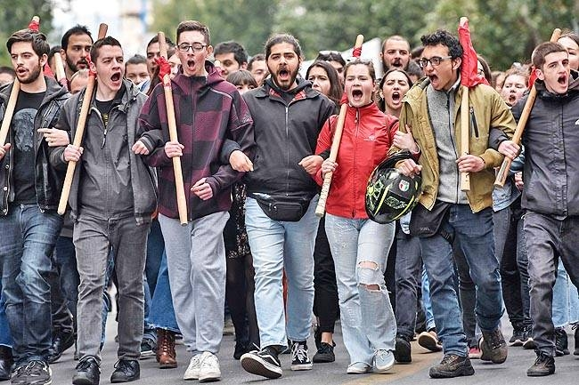 Pupils demonstrate in central Athens against a new educational reform, changing the exams system for higher education. - AFP