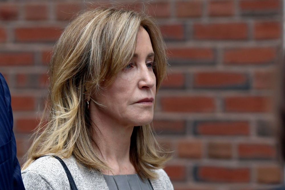 Actor Felicity Huffman leaves the federal courthouse after facing charges in a nationwide college admissions cheating scheme in Boston, Massachusetts, on Monday. — Reuters