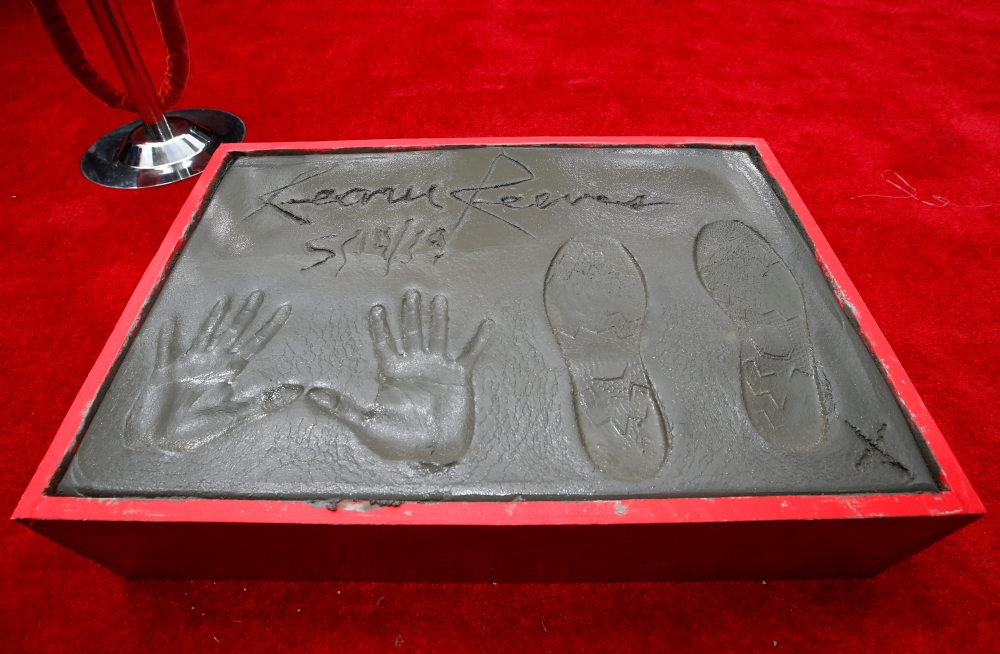 Hand and footprints of Keanu Reeves are put in cement, in the forecourt of TCL Chinese theater in Los Angeles. — Reuters