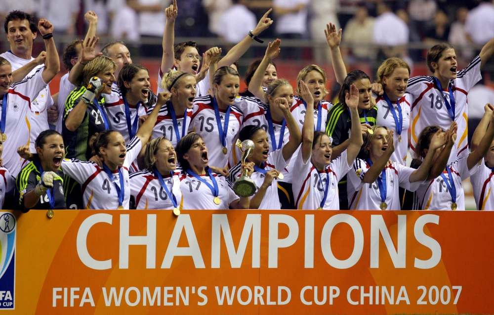 Germany's team celebrates after defeating Brazil in the final of the 2007 FIFA Women's World Cup soccer tournament in Shanghai in this file picture . — Reuters