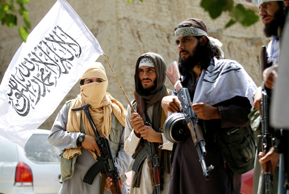 Taliban insurgents walk as they celebrate cease-fire in Ghanikhel district of Nangarhar province, Afghanistan, in this June 16, 2018 file photo. — Reuters