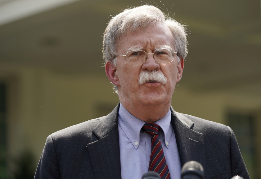 US National Security Adviser John Bolton takes questions about the political unrest in Venezuela, outside the White House in Washington, in this April 30, 2019 file photo. — Reuters