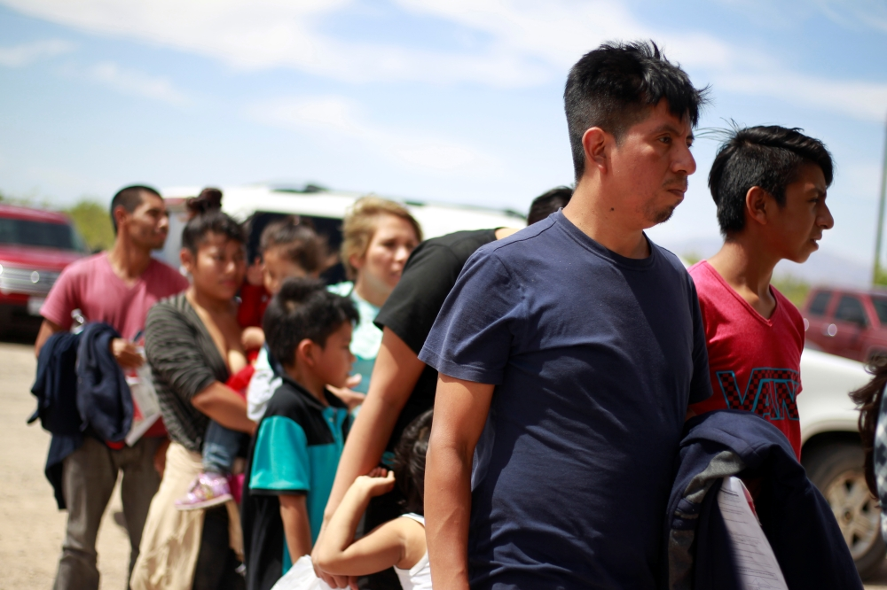 Central American migrants stand in line before entering a temporary shelter, after illegally crossing the border between Mexico and the US, in Deming, New Mexico, on Thursday. — Reuters