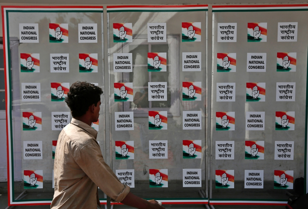 A man walks past the headquarters of India's Congress party in New Delhi May 16. - Reuters