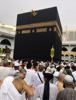 Pilgrims and visitors enjoy welcome showers that blessed the holy city of Makkah on Saturday. — SPA