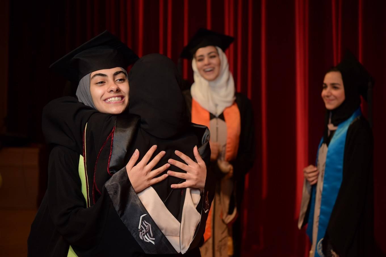Dar Al-Hekma students rejoice at their graduation party on Thursday.