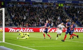 Lyon's Memphis Depay celebrates scoring their fourth goal in Lyon, France, on Saturday. — Reuters