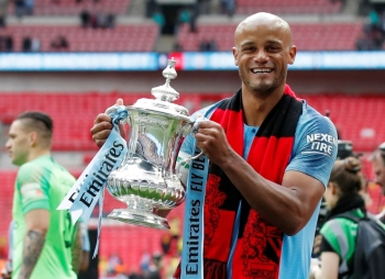 Manchester City's Vincent Kompany celebrates with the trophy after winning the FA Cup at the Wembley Stadium, London, in this May 18, 2019 file photo. — Reuters