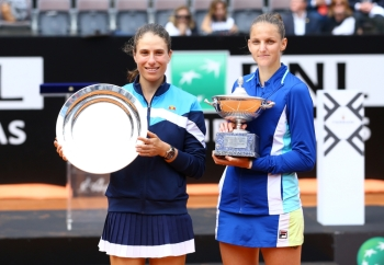 Czech Republic's Karolina Pliskova and Britain's Johanna Konta pose with their trophies after the final in Rome, Sunday. — Reuters