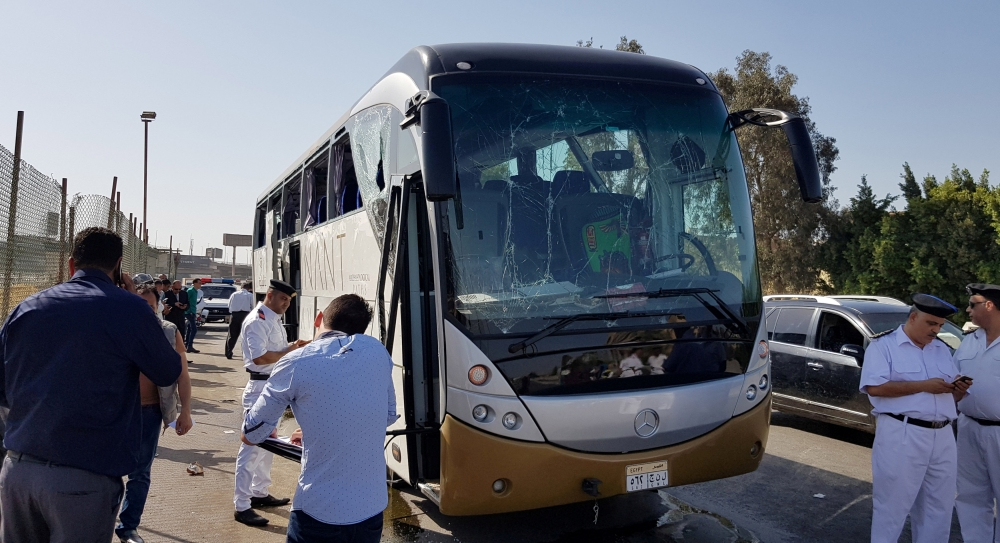 A damaged bus is seen at the site of a blast near a new museum being built close to the Giza pyramids in Cairo. — Reuters