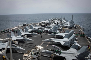 Flight deck of the US aircraft carrier USS Abraham Lincoln (CVN 72) is seen as sailors swipe the deck for foreign object and debris (FOD) walk-down on the flight deck of the Nimitz-class aircraft carrier USS Abraham Lincoln (CVN 72) in Arabian Sea. — Reuters