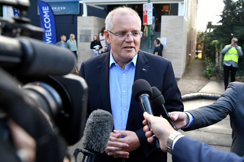 Australian Prime Minister Scott Morrison speaks to the media May 19. - Reuters