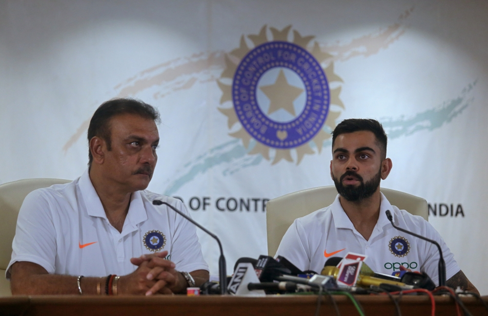 India's captain Virat Kohli speaks as head coach Ravi Shastri looks on during a news conference at the Board of Control for Cricket in India (BCCI) headquarters in Mumbai, India, on Tuesday. — Reuters