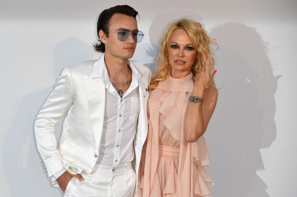 US actress Pamela Anderson, right, and her son Brandon Thomas Lee pose as they arrive on Thursday for the amfAR 26th Annual Cinema Against AIDS gala at the Hotel du Cap-Eden-Roc in Cap d'Antibes, southern France, on the sidelines of the 72nd Cannes Film Festival. — AFP