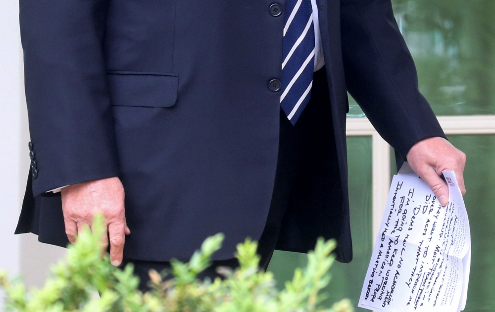 US President Donald Trump carries his own handwritten notes as he walks out of the Oval Office to speak to reporters about the investigations into himself and his administration by Special Counsel Robert Mueller and congressional Democrats in the Rose Garden at the White House in Washington in this May 22, 2019 file photo. — Reuters