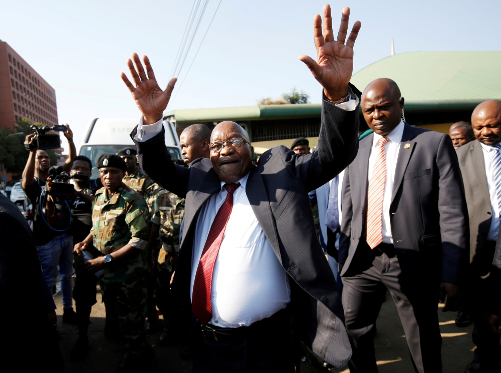 Former President Jacob Zuma waves to supporters after his appearance in the High Court where he faces charges that include fraud, corruption and racketeering, in Pietermaritzburg, South Africa, on Friday. — Reuters