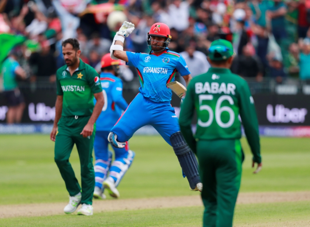 Afghanistan's Hashmatullah Shahidi celebrates victory against Pakistan in the ICC Cricket World Cup warm-up match at the  County Ground, Bristol, Britain, on Friday. — Reuters