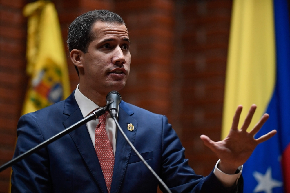 Venezuelan opposition leader and self-proclaimed interim president Juan Guaido speaks during plenary to present his national reconstruction project