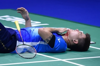 Malaysia's Teo Ee Yi lies injured during their match against Japan's Takeshi Kamura and Keigo Sonoda in their men's doubles quarterfinal match at the 2019 Sudirman Cup world badminton championships in Nanning in China's southern Guangxi region on Friday. — AFP