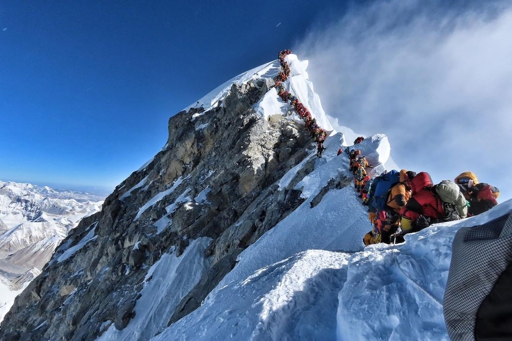 In this file handout photo taken on May 22, 2019 and released by climber Nirmal Purja's Project Possible expedition shows heavy traffic of mountain climbers lining up to stand at the summit of Mount Everest. — AFP