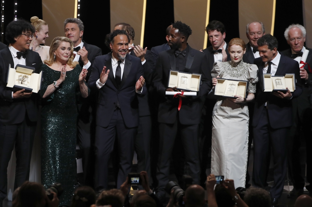Ladj Ly, Emily Beecham, Bong Joon-ho, Antonio Banderas pose on stage at Cannes on Saturday. — Reuters