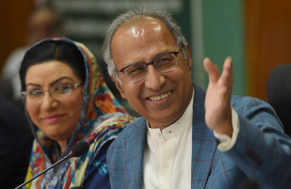 Adviser to Prime Minister Imran Khan on Finance, Revenue and Economic Affairs Abdul Hafeez Shaikh, left, gestures during a press conference next to special assistant to the Prime Minister for Information and Broadcasting Firdous Ashiq Awan, in Islamabad, on  Saturday. — AFP