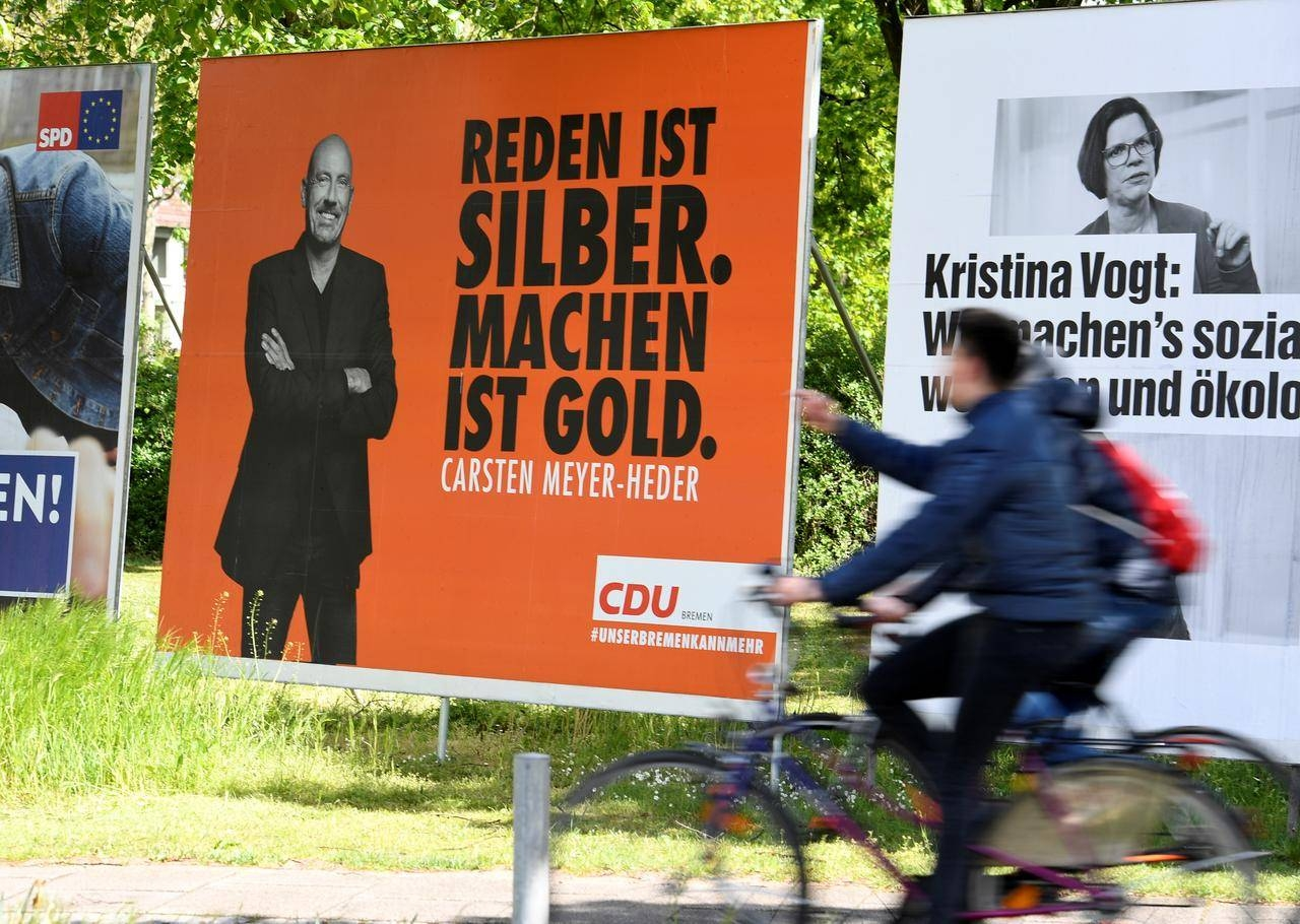 Election posters of Carsten Meyer-Heder, Germany's Christian Democrats Union (CDU) top candidate, and Kristina Vogt, top candidate of the German left-wing Die Linke party, are seen in Bremen, Germany May 4. — Reuters