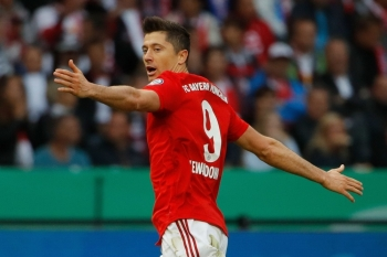 Bayern Munich's Polish forward Robert Lewandowski celebrates scoring the opening goal during the German Cup (DFB Pokal) final football match against RB Leipzig at the Olympic Stadium in Berlin on Saturday. — AFP