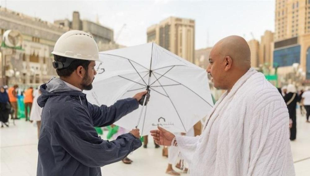 Pilgrim care, the Saudi authorities distributing umbrellas to pilgrims in the Grand Mosque in Makkah to keep them protected from the scorching sun. — SPA