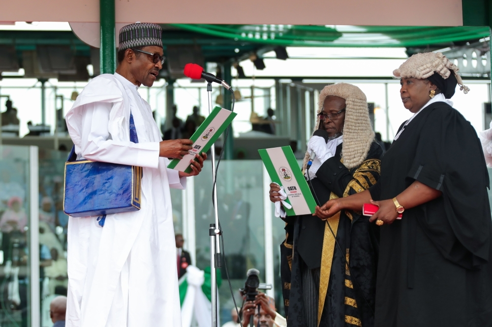 A handout image released by the Nigerian Presidential Press Services on Wednesday shows Nigerian President Muhammadu Buhari being sworn in during his inauguration ceremony in Abuja. — AFP