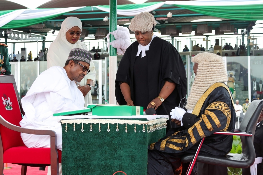A handout image released by the Nigerian Presidential Press Services on Wednesday shows Nigerian President Muhammadu Buhari being sworn in during his inauguration ceremony in Abuja, Nigeria. — AFP