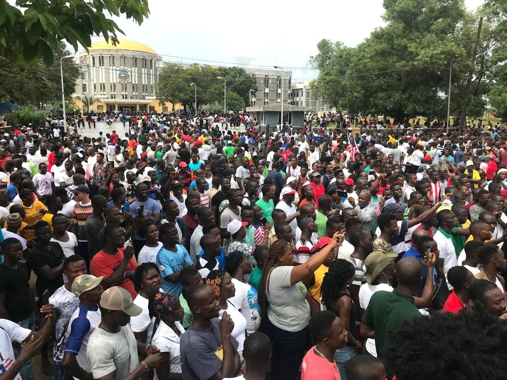 Demonstrators gather outside the Liberian Mansion in Monrovia during an anti-government march to protest at inflation and corruption on Friday. — AFP