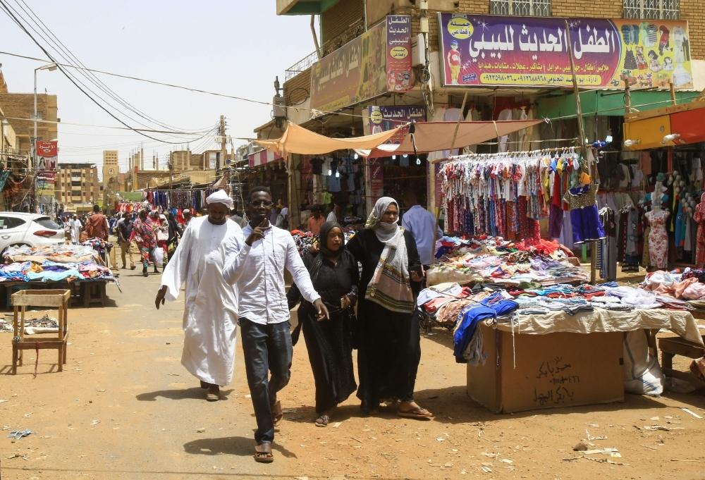 Shoppers walk through the great market of Omdurman, the Sudanese capital Khartoum's twin city, on Saturday.  — AFP
