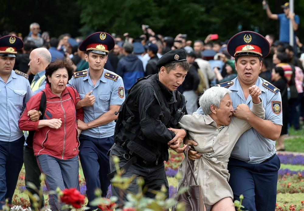 Police officers detain opposition supporters during a protest against presidential election, in Almaty, Kazakhstan, Sunday. — Reuters
