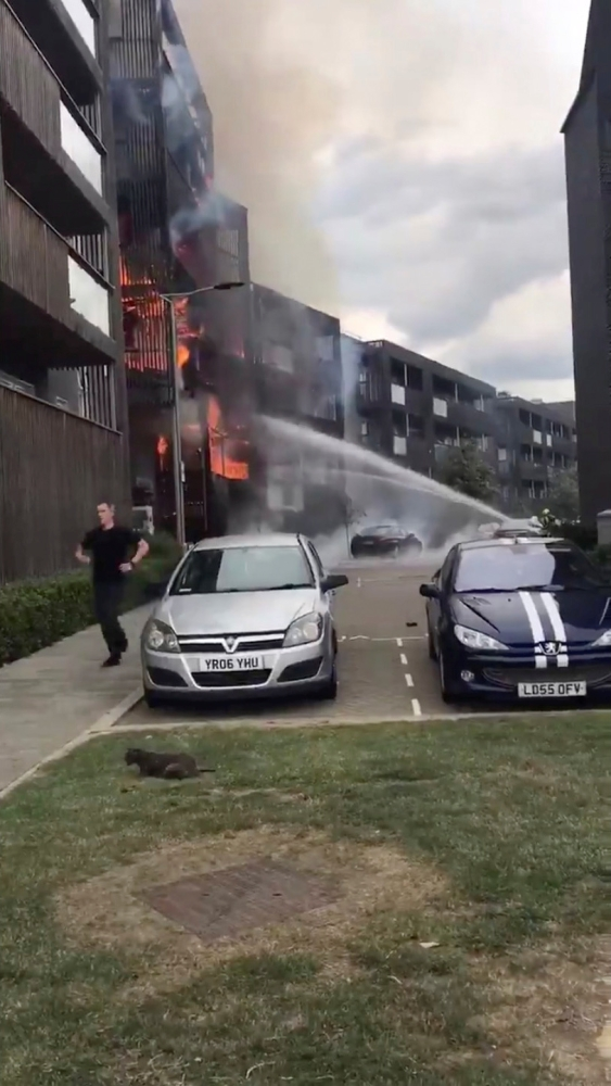 A still image taken from a video obtained on social media shows a fire in a block of flats in Barking, East London, Britain, Sunday. — Reuters