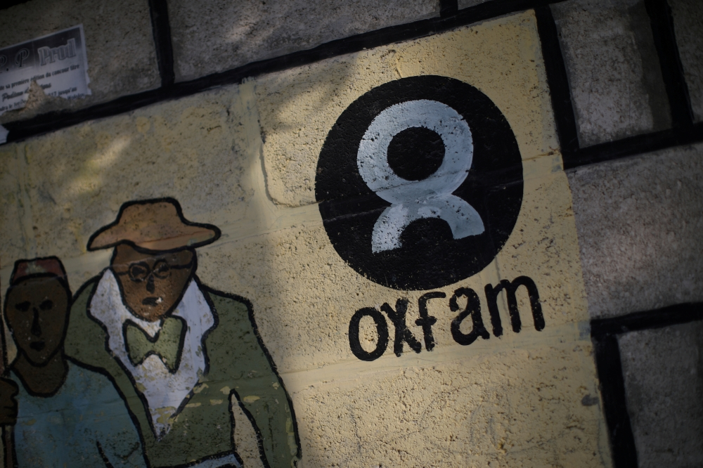 An Oxfam sign is seen on a wall in Corail, a camp for displaced people of the earthquake of 2010, on the outskirts of Port-au-Prince, Haiti, in this Feb. 17, 2018 file photo. — Reuters