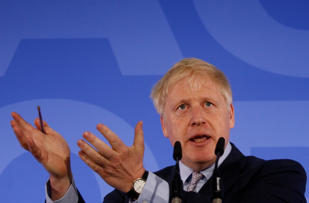 Conservative Party leadership candidate Boris Johnson gestures as he talks during the launch of his campaign in London on Wednesday. — Reuters