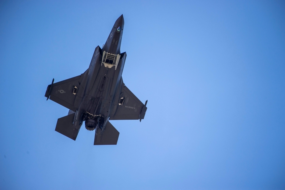 An F-35 fighter plane flies over the White House in Washington on Wednesday. — AFP