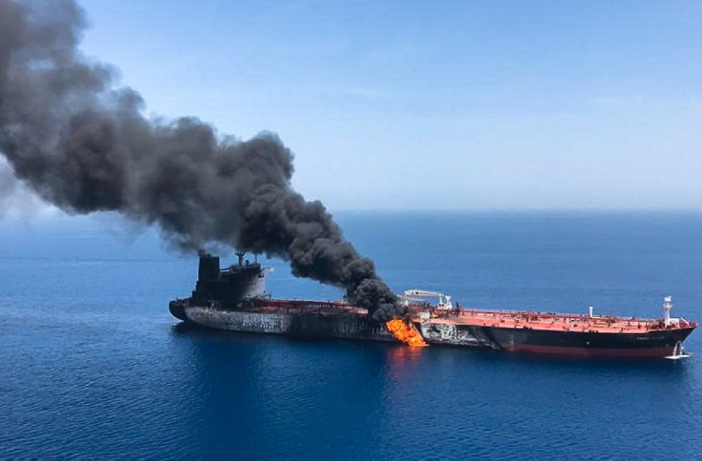 A picture obtained by AFP on Thursday reportedly shows fire and smoke billowing from a tanker said to have been attacked in the waters of the Gulf of Oman. — AFP