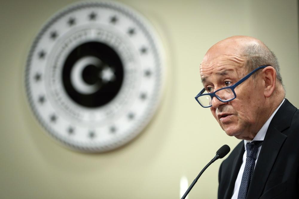 A handout photo shows French Foreign Minister Jean-Yves Le Drian speaking during a press conference with his Turkish counterpart in Ankara, on Thursday. — AFP