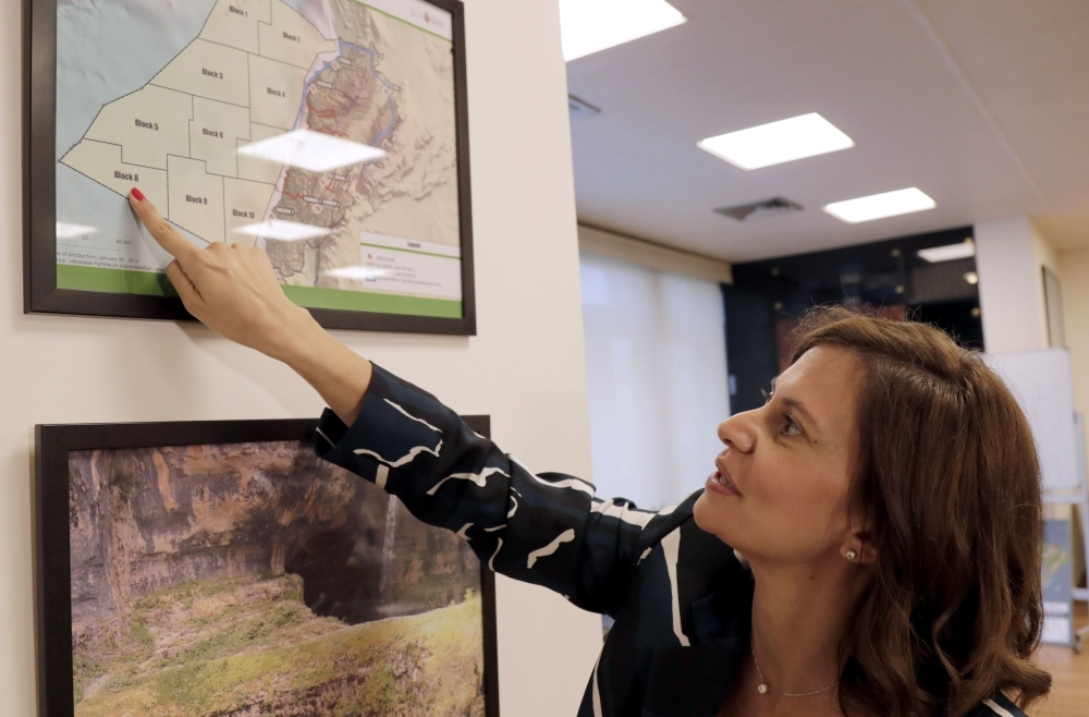 Lebanese Energy Minister Nada Boustani displays a map of offshore oil and gas blocks in the Mediterranean, on Thursday during an interview to AFP in Beirut. Russian and European firms are mulling investments in Lebanon's nascent oil and gas sector, as the country prepares to launch offshore drilling by the end of the year, said energy minister Nada Boustani. — AFP