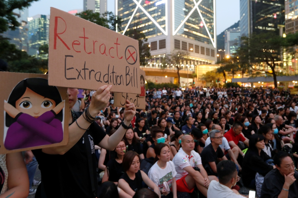 People attend a rally in support of demonstrators protesting against proposed extradition bill with China, in Hong Kong, China, Friday. — Reuters