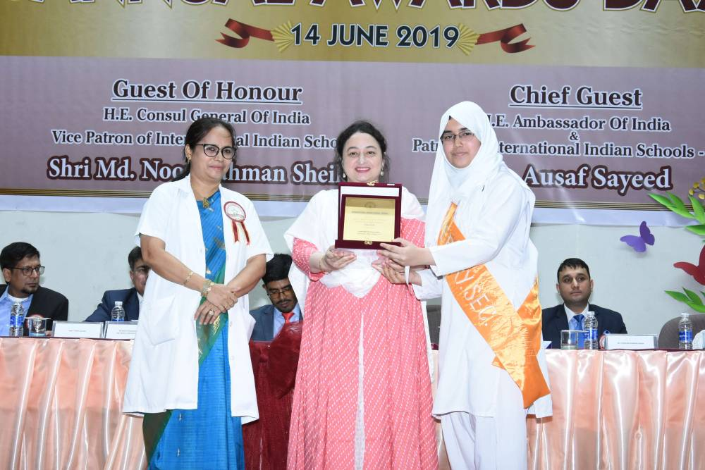 A girl student receives her award.
