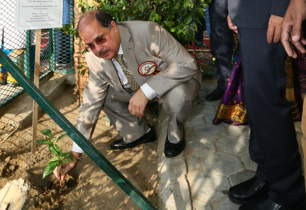 Dr. Ausaf Sayeed planting a tree in the school premises.