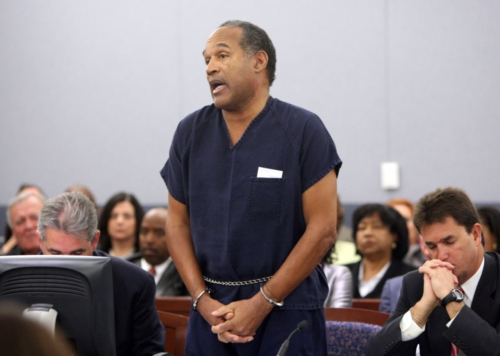 OJ Simpson speaks in court prior to his sentencing as his attorneys Gabriel Grasso, left, and Yale Galanter listen at the Clark County Regional Justice Center in Las Vegas, Nevada, in this Dec. 4, 2008 file photo. — AFP