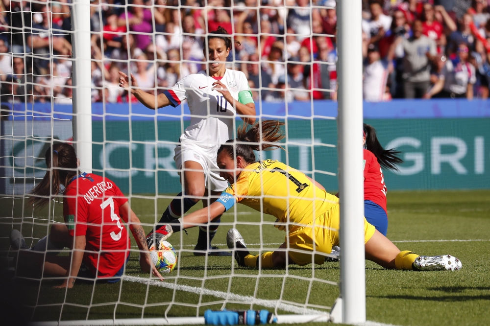 Chile goalkeeper Christiane Endler (1) makes a save against the United States forward Carli Lloyd (10) in group stage play during the FIFA Women's World Cup France 2019 at Parc des Princes on Sunday. — Reuters