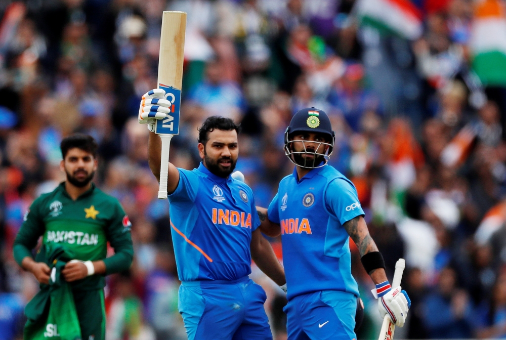 India's Rohit Sharma celebrates his century with Virat Kohli during the ICC Cricket World Cup match against Pakistan at the Emirates Old Trafford, Manchester, Britain on Sunday. — Reuters