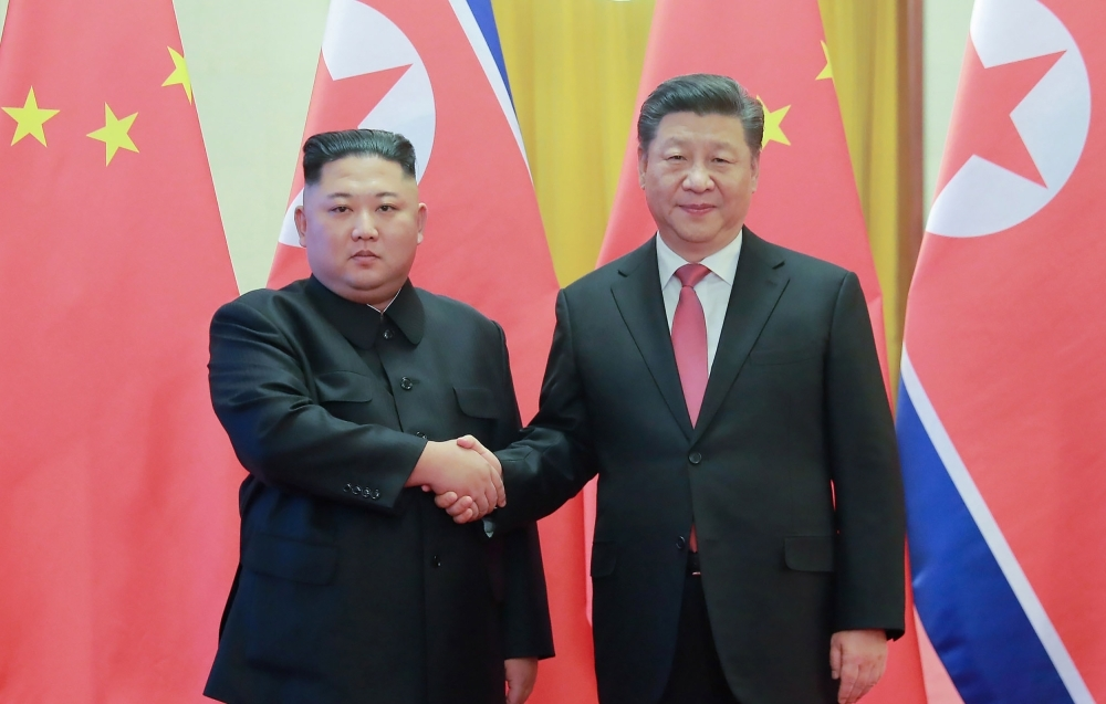 North Korea's leader Kim Jong Un, left, shakes hands with China's President Xi Jinping during a welcome ceremony at the Great Hall of the People in Beijing in this Jan. 8, 2019 file photo. — AFP