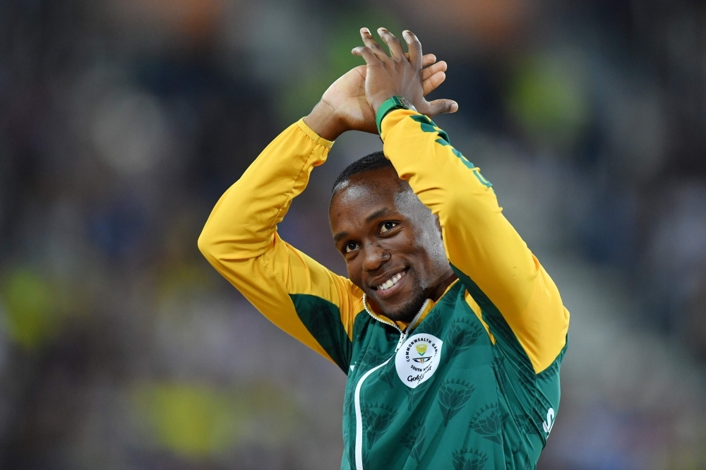 In this file photo taken on April 10, 2018, Gold medalist South Africa's Akani Simbine reacts during the athletics men's 100m final medal ceremony during the 2018 Gold Coast Commonwealth Games at the Carrara Stadium on the Gold Coast.  — AFP